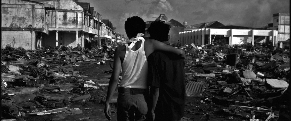 Young men facing the devastating of the 2004 Indian Ocean Earthquake and Tsunami
