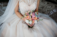 Bridal bouquet in the hands of the newly