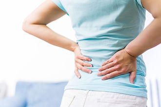 back pain at home. women suffer from bac