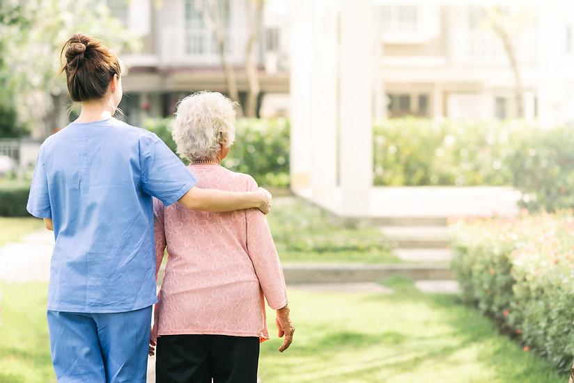 nurse-caregiver-support-walking-with-eld