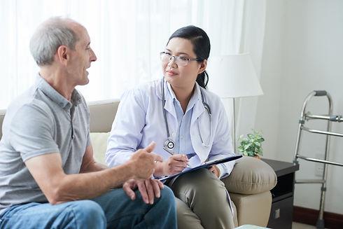 asian-female-doctor-talking-senior-cauca