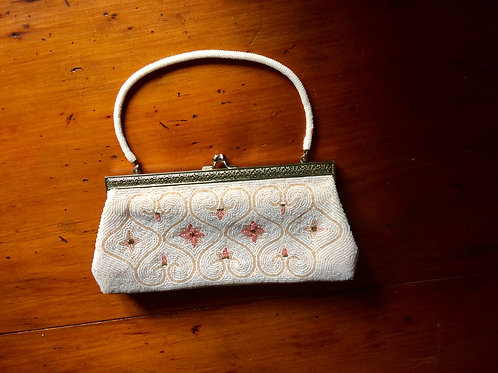 Beaded handbag with pink flower