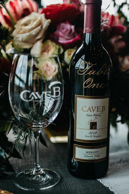 Engraved Wine Bottle as a Table Number at Cave B Winery