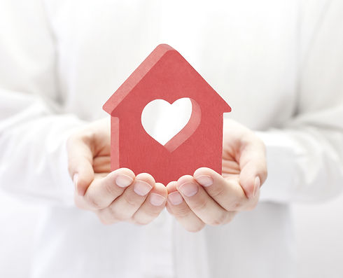 Small red house with heart in hands .jpg