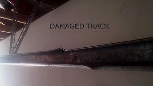 Damaged or Broken Garage Door Track