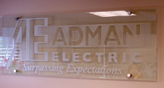sand blasted etched glass sign.JPG