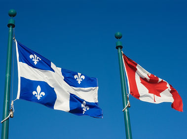 Quebec and Canada flags fluttering in th