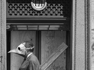 Man in Boarded Doorway
