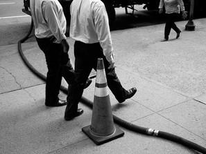Men and Steam Hose