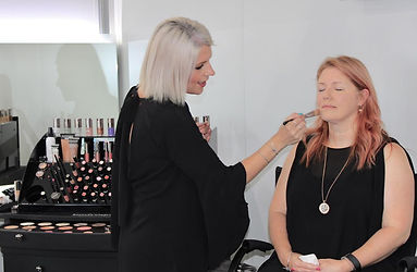 Bodyography makeup artist applying makeup to one of our makep clients