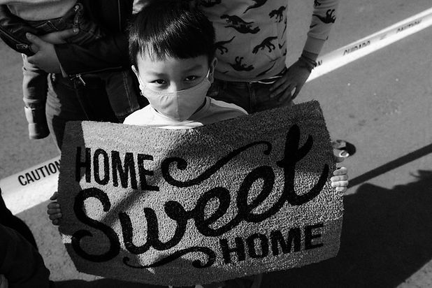 Boy with welcome mat