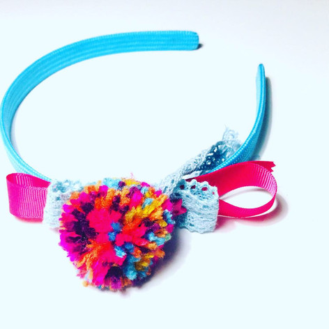 Multicolour single pompom headband £12