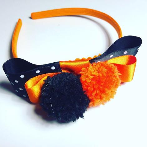 Orange & black pompom headband £12