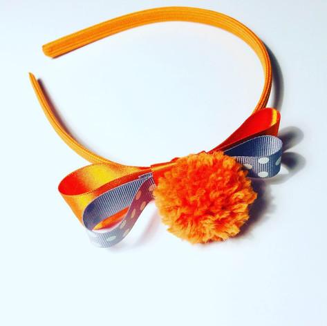 Orange single pompom headband £12