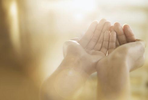 Hands open to receive