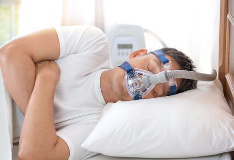 man-sleeping-in-bed-wearing-cpap-mask-sl