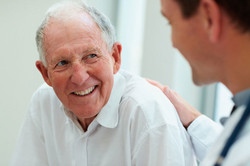 Elderly-male-patient-smiling-at-male-doc