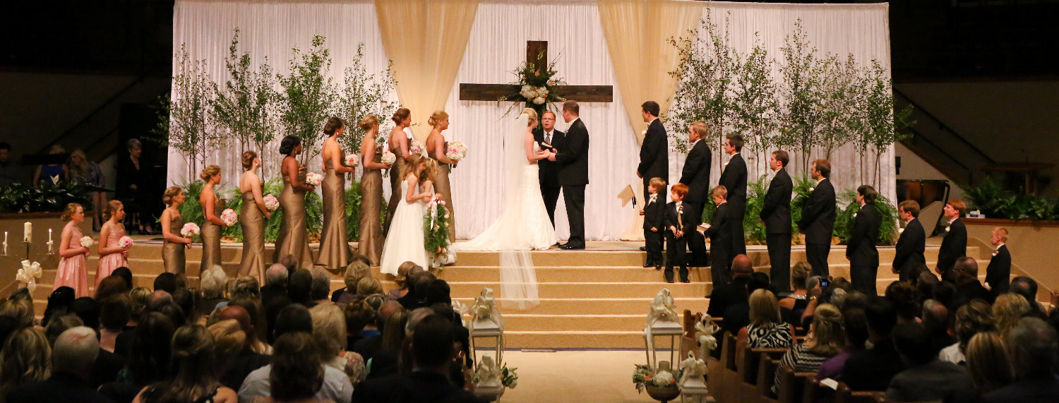 Wedding ceremony, church wedding, large wooden cross