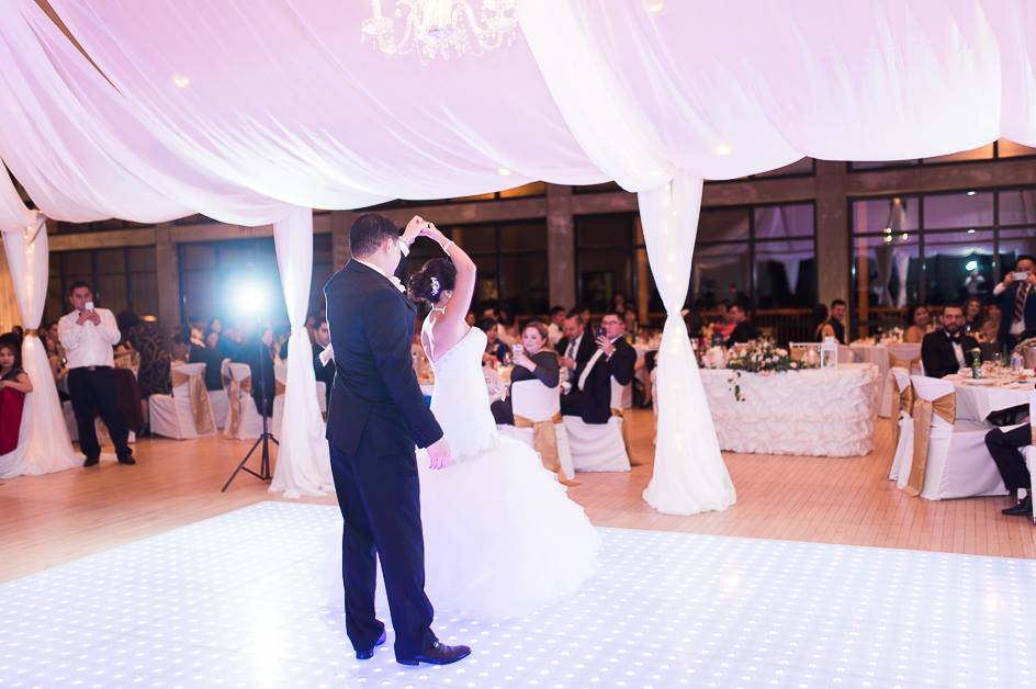 First Dance Under Beautiful Draping and Chandeliers