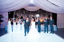Blue uplighting, silver and white fabric draping