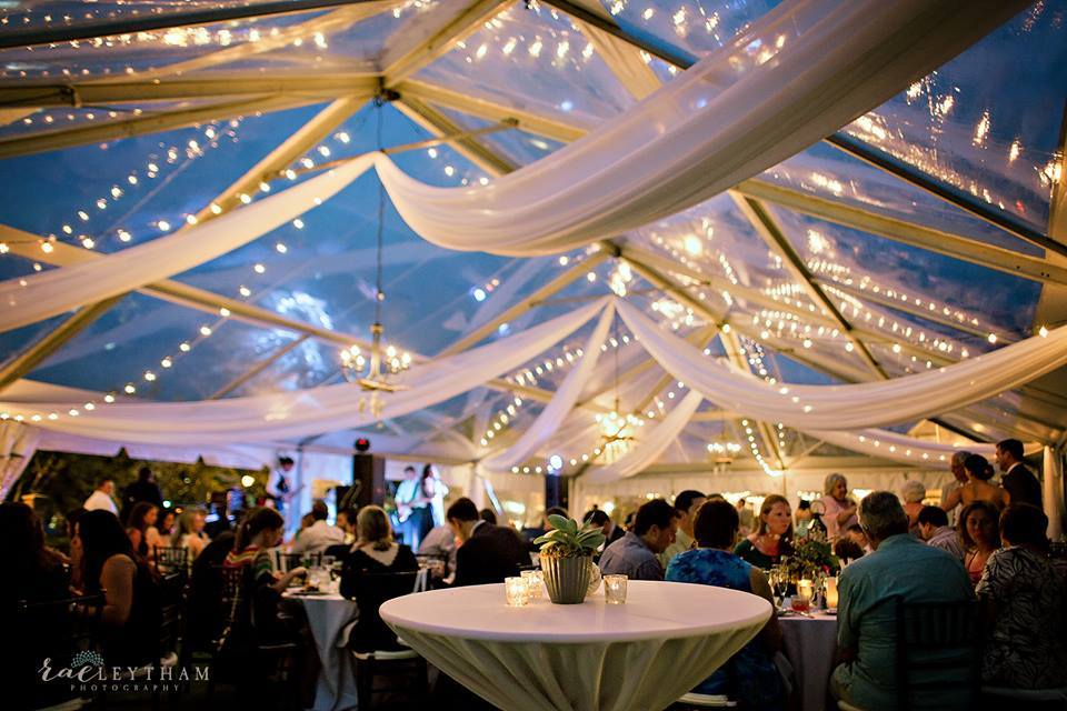 Tent draping, bistro lights, chandeliers