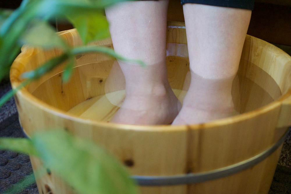 Image of person with feet in foot bath