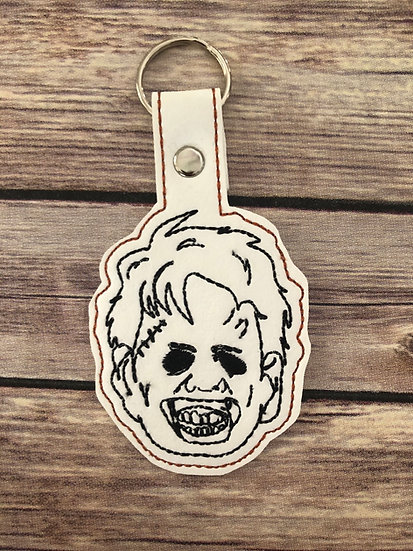 Leather Face Embroidered Key Chain