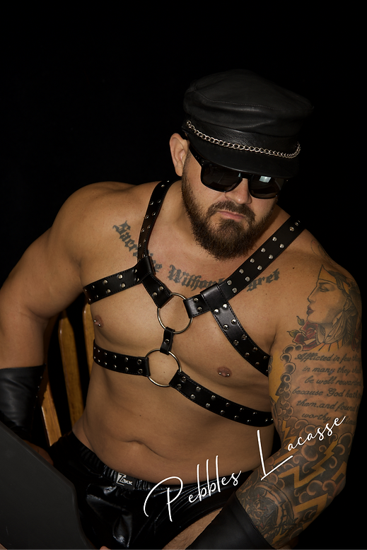 Dominant Chris with hat by Pebbles Lacasse