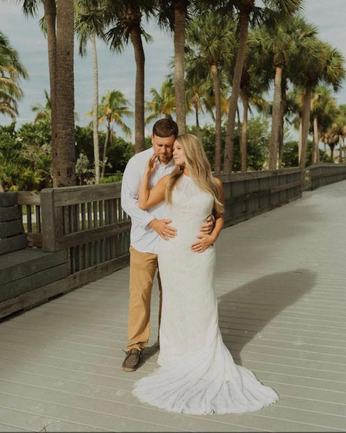 bride and groom at the pier