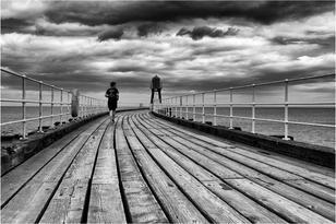 On the Pier by John Wickett