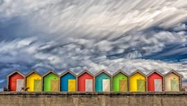 Beach Huts by Derrick Holliday