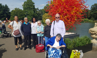Group photo in front of glass sun at Kew Gardens Outing