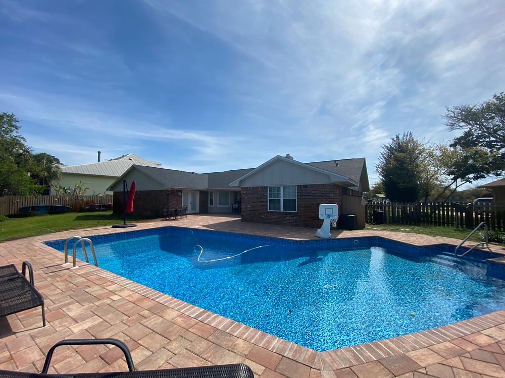 Backyard pool photo before a roofing job