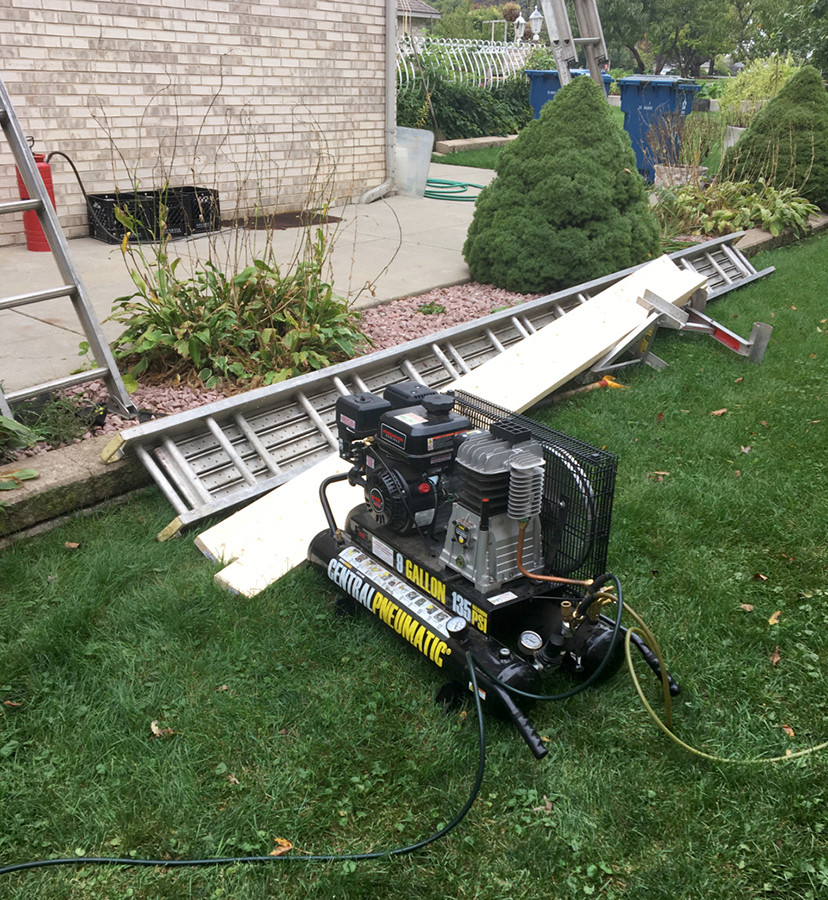 generator being used during a roof install jobsite