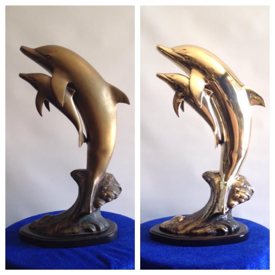 Before/after Brass dolphin statue