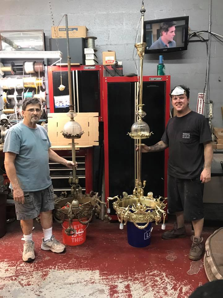 Owner and son with 1800s gasolier
