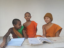 monks reading a book.jpg