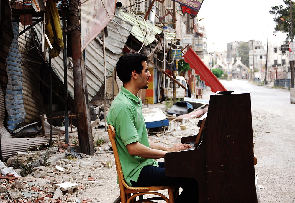 Concert pianist Aeham Ahmad performs in his conflict stricken native Syria