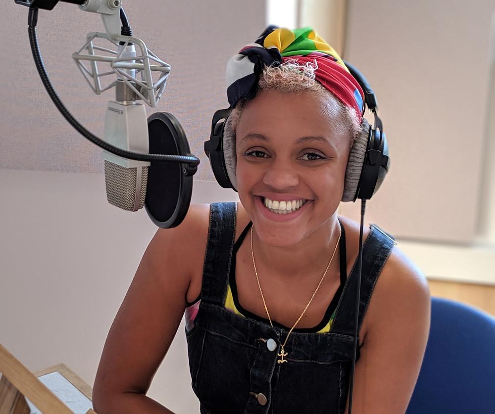 Broadcaster and DJ Gemma Cairney in the studio narrating Anneka Harry's new Gender Rebels audiobook