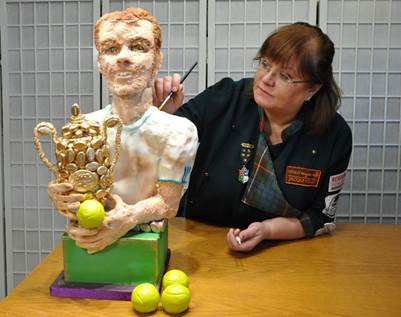 Food artist Jacqui Kelly showcases her Candy Murray statue at the launch of Wimbledon Art Fair