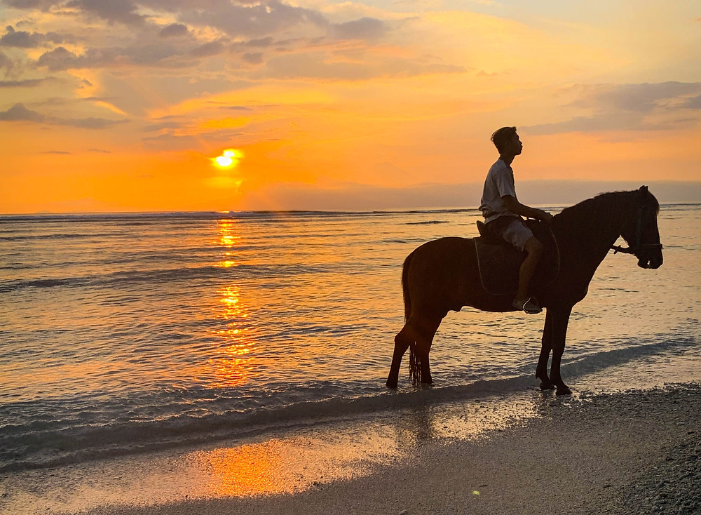 A trip to Gili Trawangan is not complete without watching the sunset. Or you can watch the sunset from the back of a horse for extra island vibes.