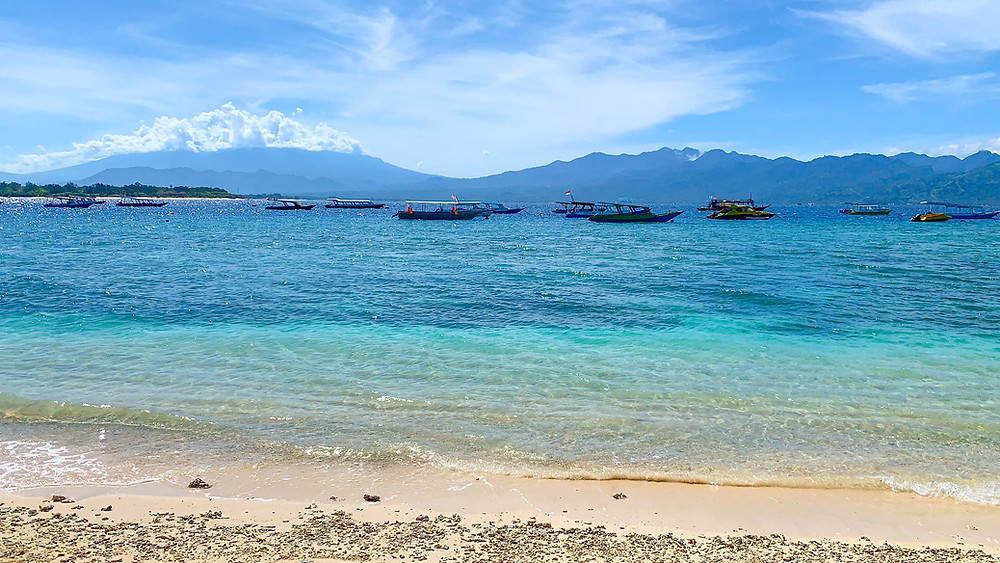 A beach on Gili T with clear turquoise blue water and white sandy beaches
