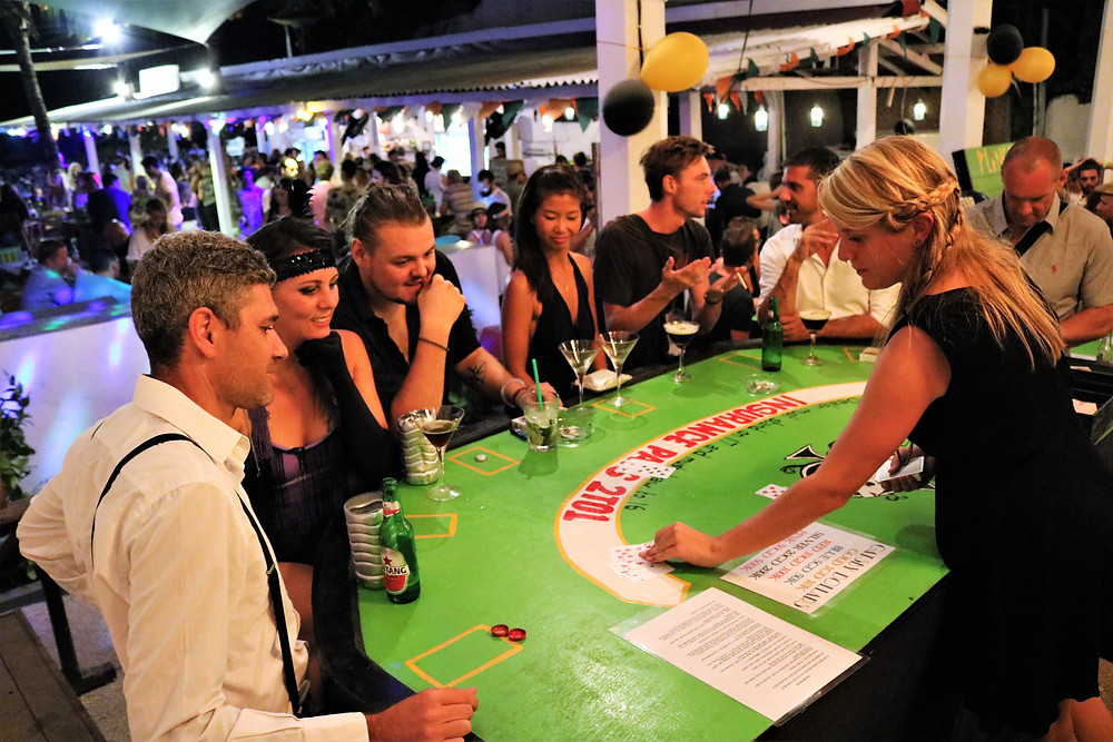 Great Gatsby themed casino guests playing blackjack