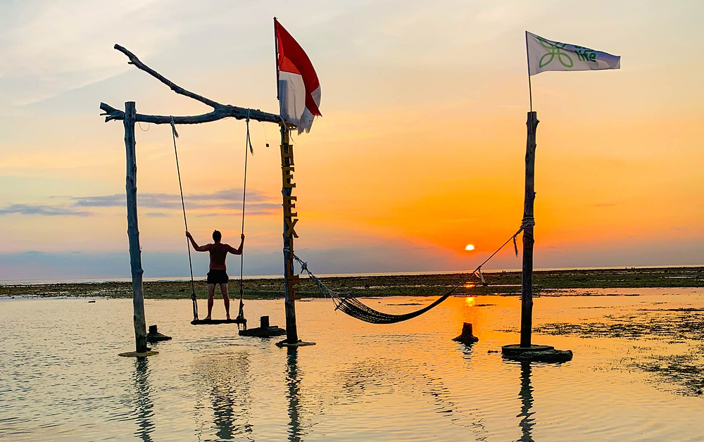 It doesn't get much more Gili T than watching the sunset from an ocean swing!