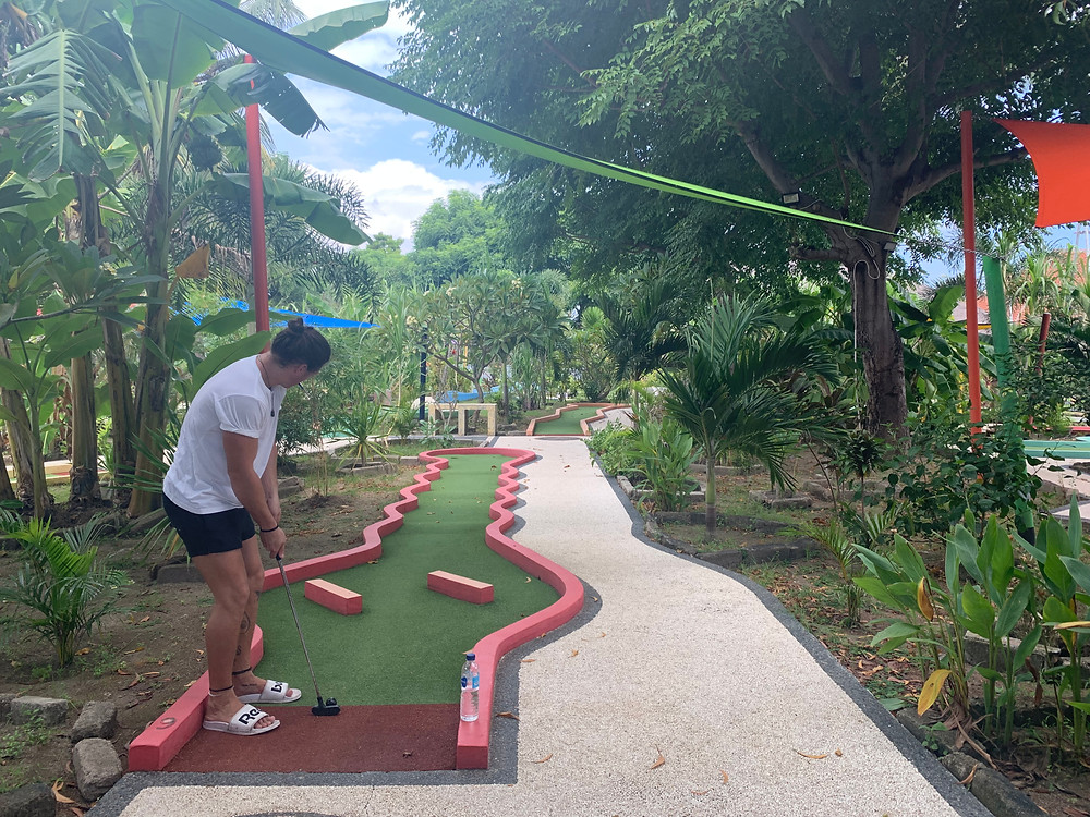 A tourist about to score a hole in one at Gili Golf in Gili T