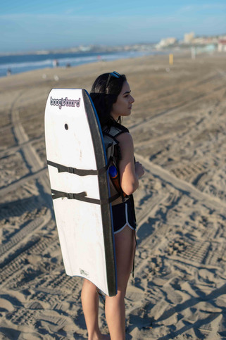 Back view of girl with Beach Porter and Boogie Board