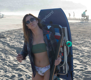 Girl wearing chair with Beach Porter and Boogie Board