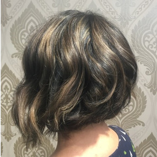 Layered Lob Bob That Can Be Worn Curly Or Straight.