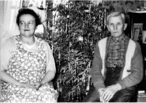 Aunt Agnes and Grandpa Charly Kuehn in front of a Christmas tree