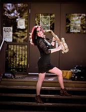 monica saxophon with yellow purse.jpg